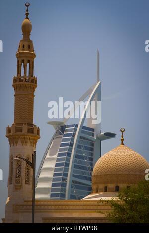 Burj al Arab Hotel and mosque. Jumeirah area. Dubai city.  Dubai. United Arab Emirates. - Stock Photo