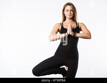 yoga girl on white background lying in shavasana savasana