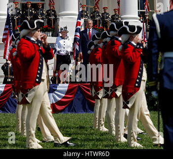 Queen Elizabeth II of the United Kingdom and President George W Bush observe the Fife and Drum Corp during the Queen's - Stock Photo