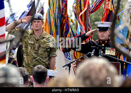 Britain's Prince Harry and emcee United States Marine Staff Sergeant Joshua Miles salute during the playing of the - Stock Photo