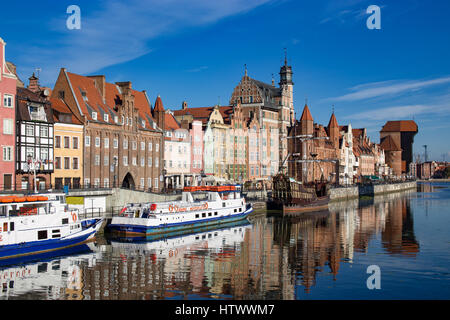 Gdansk, Danzig an old medieval polish and german city, the old granary - Krantor. View on sunny day with blue sky - Stock Photo