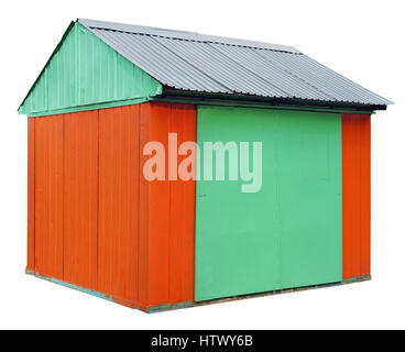 The rural shed is made of corrugated iron sheets and painted with orange and green paint. No name mass production - Stock Photo