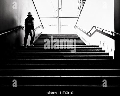 A woman walking up the stairs - Stock Photo