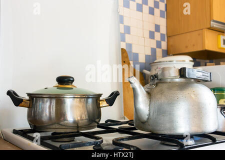 Pot and kettle on a gas stove - Stock Photo
