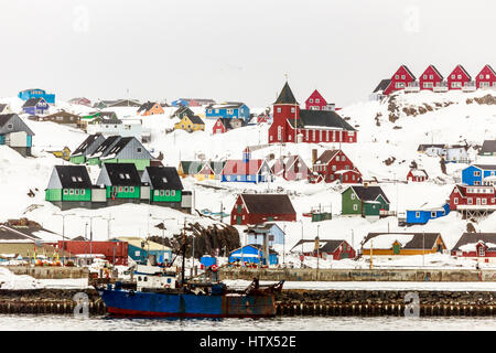 Colorful houses and church on the hill, Sisimiut town view from seaside, Greenland - Stock Photo