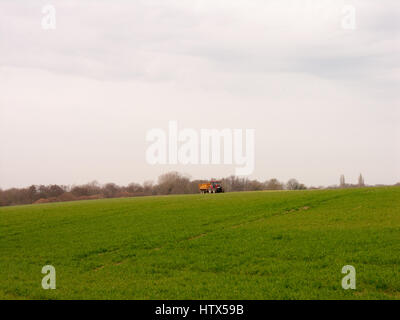 A lovely field in Aresford with a tractor. - Stock Photo