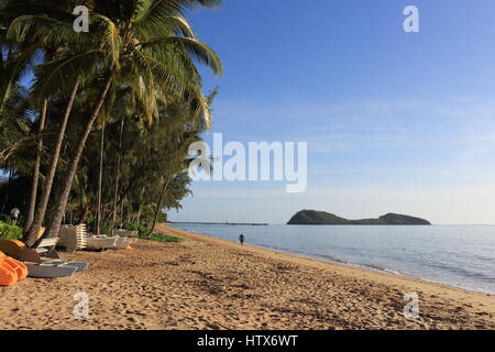 Palm Cove beach on a still morning, middle to north aspect from water toy hire point towards the fishing jetty, - Stock Photo