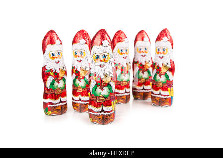 Closeup of Santa Claus chocolate figures. Isolated on white background - Stock Photo