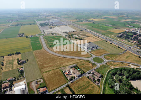 Aerial view, of new shopping center,  mall, condominium construction close to Parma, Emilia Romagna, Italiy, highway, - Stock Photo