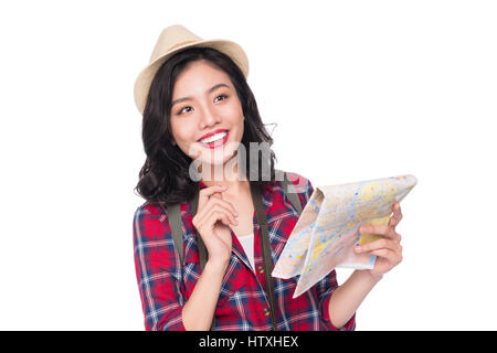 Woman travel. Young beautiful asian woman traveler watching map standing over white. - Stock Photo