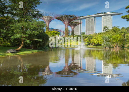 Gardens by the Bay and Marina Bay Sands Hotel, Singapore - Stock Photo