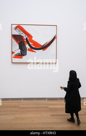 Woman looking at painting Hammer and Sickle by Andy Warhol at Hamburger Bahnhof modern art museum in Berlin, Germany - Stock Photo