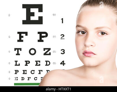 young girl with test vision table over background. concept of preservation children's vision - Stock Photo