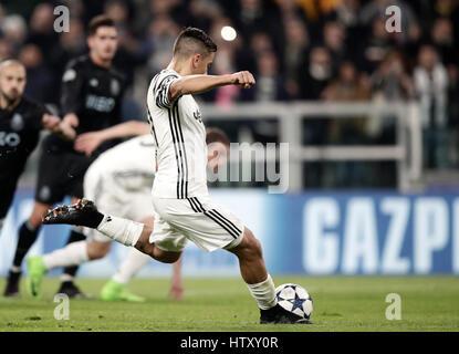 Turin, Italy. 14th Mar, 2017. JuventusÕ Paulo Dybala kicks to score on a penalty kick during the Champions League - Stock Photo