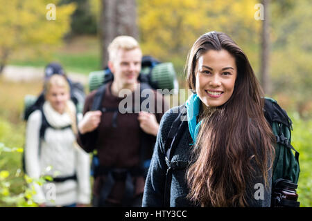 Portrait Of Beautiful Young Woman Hiking In Forest - Stock Photo