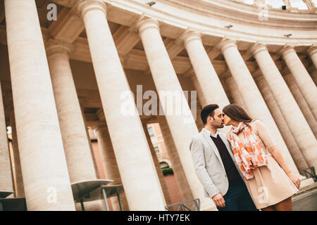 Loving couple at the St. Peter's Square in Vatican - Stock Photo