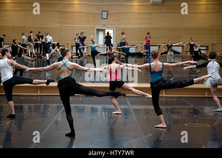 Ballerinas rehearse dance elements in the rehearsal room of the Bolshoi Theater of Russia in Moscow - Stock Photo
