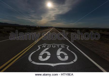 Full moon over Route 66 in the California Mojave desert. - Stock Photo