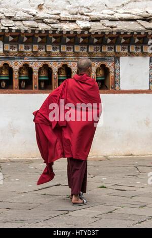 Bhutan, Paro, Rinpung Dzong. Novice monk at 15th century Buddhist monastery and fortress. Tentative List for UNESCO - Stock Photo