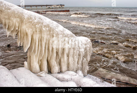 Close-up of Ice covered staircase by the beach, Baltic Sea, Kaliningrad, Russian Federation - Stock Photo
