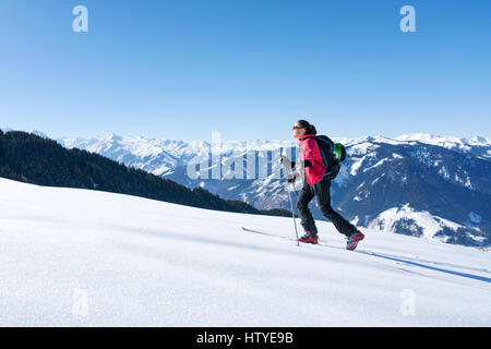 Woman cross-country skiing, Zell am see, Salzburg, Austria - Stock Photo