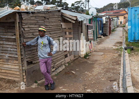 South Africa Townships - a man standing in the street, Imizamo Yethu Township, Cape Town, South Africa