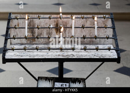 Lit prayer candles in st Mary's church Oxford - Stock Photo