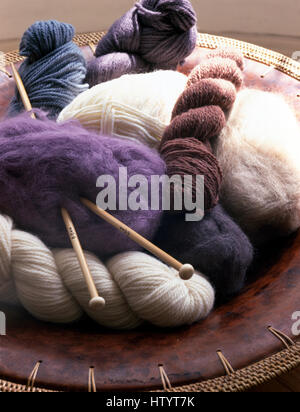 Close-up of skeins of wool and knitting needles - Stock Photo