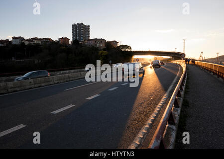 Sunset light reflecting on a highway, making long car shadows (Guipuzcoa, Basque country) 2017.