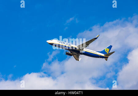 London, UK - March 13, 2017: Boeing 737-8AS (registration number: EI-DHA) operated by Ryanair flights in the sky - Stock Photo