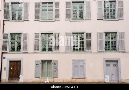 Facade of an old typical Swiss medieval house in pastel coulours in Basel old town, Altstadt Grossbasel, Switzerland. - Stock Photo