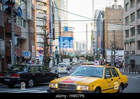 TOKYO - DECEMBER 31, 2016: A Taxi at Ginza District December 31, 2016 in Tokyo, Japan. Ginza extends for 2.4 km - Stock Photo