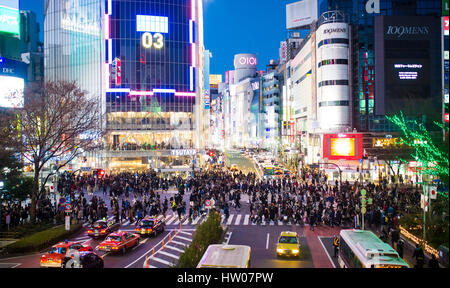 TOKYO, JAPAN - JANUARY 04, 2017: Pedestrians cross at Shibuya Crossing. It is one of the world's most famous scramble - Stock Photo