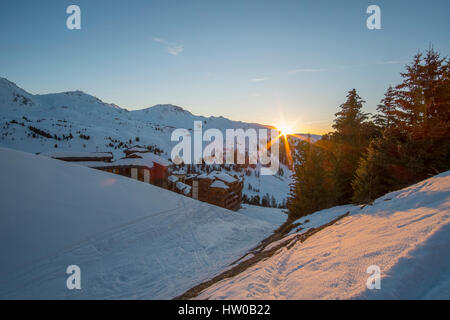 La Plagne, Savoie, France. 15th Mar, 2017. Sunset over mountains casts golden light over Belle Plagne village in - Stock Photo