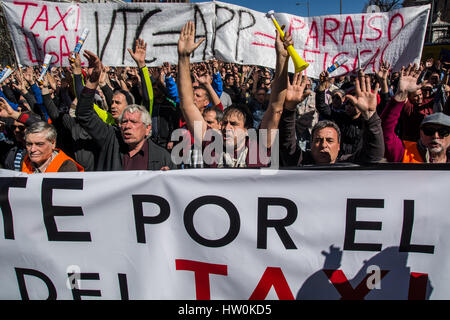 Madrid, Spain. 16th March 2017. People protesting during a demonstration of taxi drivers against private services - Stock Photo