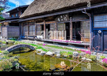 Old japanese garden view room with sliding shoji doors for Tj garden rooms