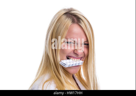 Woman with pill packet in the mouth, Frau mit Pillenpackung im Mund - Stock Photo