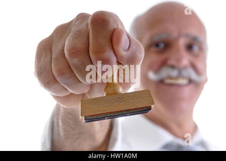 Businessman holds stamp in the hand, Geschäftsmann hält Stempel in der Hand - Stock Photo
