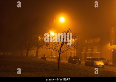 Amber-yellow glow from sodium vapor street lights in a misty night, Queensbury, Harrow, northwest London, England, - Stock Photo