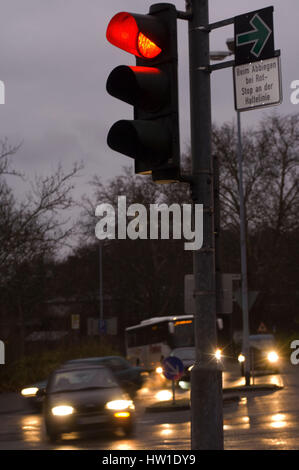 Red traffic light with the green arrow, Rote Ampel mit dem grünen Pfeil - Stock Photo