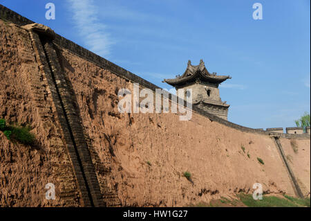 Ancient watchtower over Ming walls of Ping Yao or Pingyao town Shan Xi Province China - Stock Photo