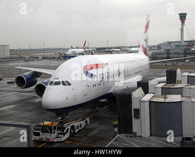 a British Airways A380 Airbus on a stand at Heathrow Airport, UK - Stock Photo