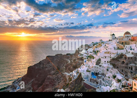 Oia or Ia at sunset, Santorini, Greece - Stock Photo