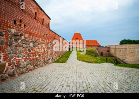 View on old Vilnius castle with red brick wall at cloudy day - Stock Photo