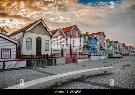 Costa Nova do Prado ( Portugal) famous home Palheiros with their houses with colorful stripes derived from original - Stock Photo