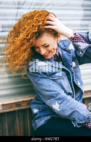Portrait of a young redhead grunge woman - Stock Photo