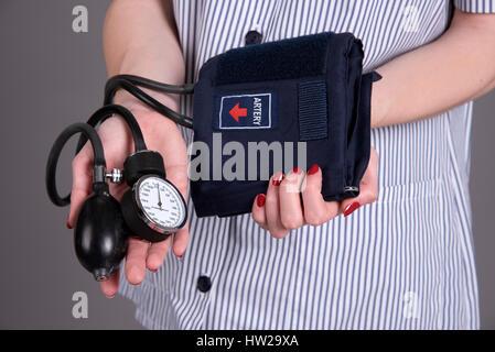 Nurse holding blood pressure measuring kit - Stock Photo