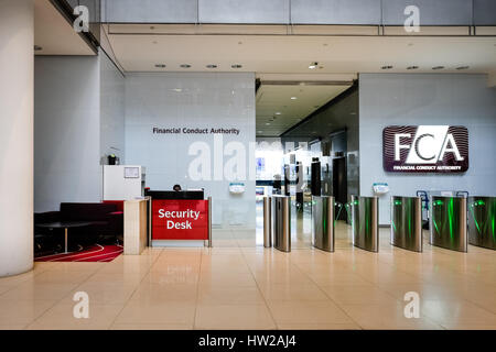Entrance lobby of the Financial Conduct Authority (FCA) building at Canary Wharf, one of London's two financial - Stock Photo