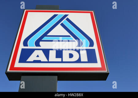 Aldi sign (north division) against blue sky. Aldi is a leading global discount supermarket chain with almost 10,000 - Stock Photo