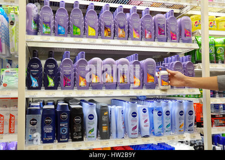 Aisle with a variety of hair care products in a Dutch Poiesz supermarket - Stock Photo